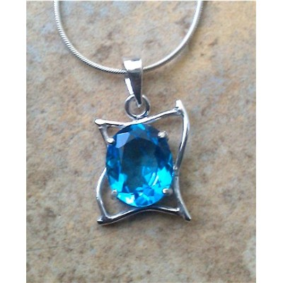 Swiss Blue Topaz in a curves setting